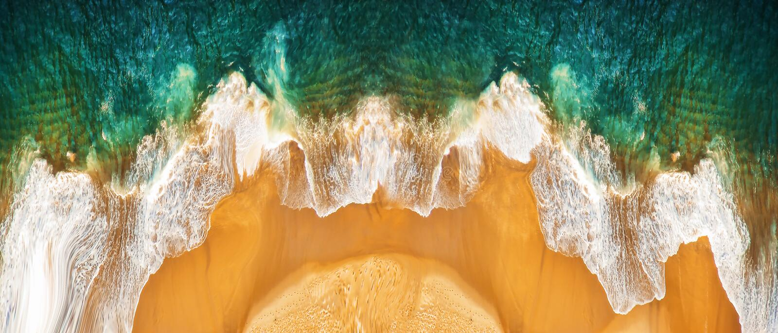 Aerial view on empty sandy tropical beach and ocean waves. Panoramic image.  stock images