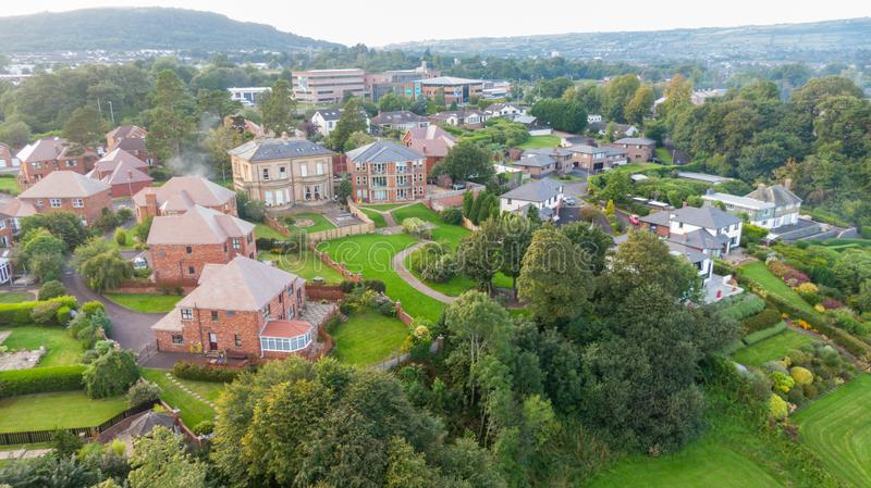 Aerial view on estate and mansions. View of Houses from above against sunset sky and mountains in Belfast Northern Ireland.  stock photography
