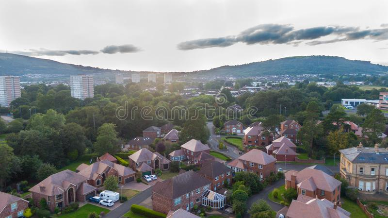 Aerial view on estate and mansions. View of Houses from above against sunset sky and mountains in Belfast Northern Ireland.  royalty free stock image