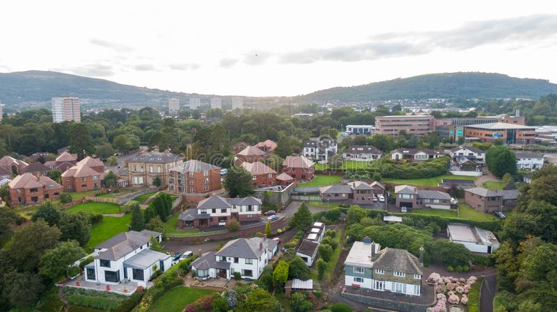 Aerial view on estate and mansions. View of Houses from above against sunset sky and mountains in Belfast Northern Ireland.  royalty free stock photography