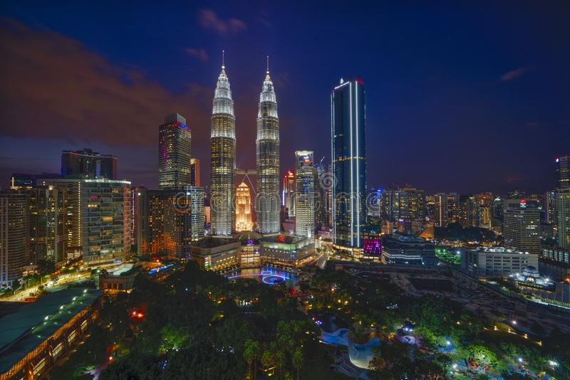 Majestic view of Petronas Twin Towers during blue hour sunset with dramatic sky. Petronas Twin Towers is the tallest building in M royalty free stock photos
