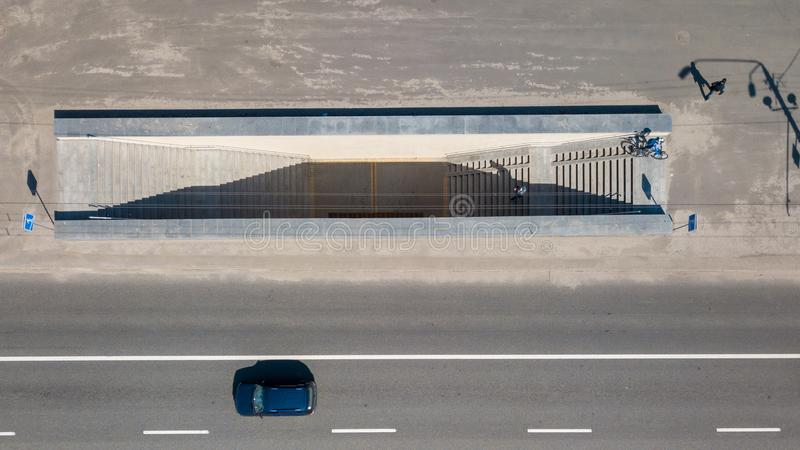 Aerial view on the of expressway across city road with an underground passage in the Kiev city. A view from above on a city road with a car and an underground royalty free stock image