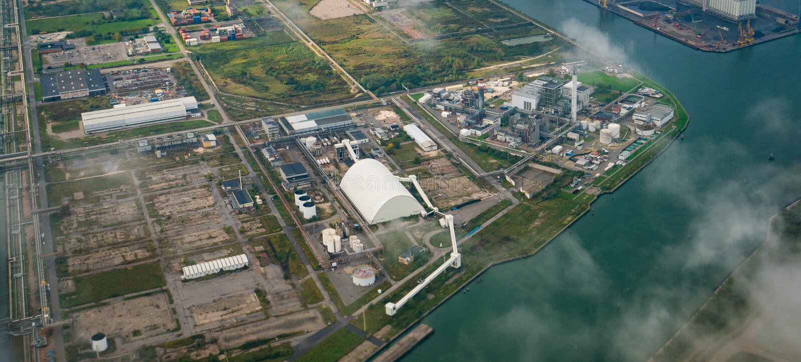 Aerial view of factories in industrial district stock photos