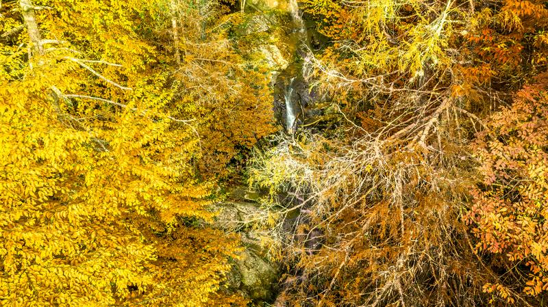 Aerial view fall colors over waterfall in North Carolina mountains stock photos