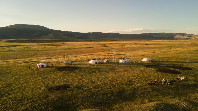 Aerial view of Mongolian ger community at sunset. royalty free stock photography