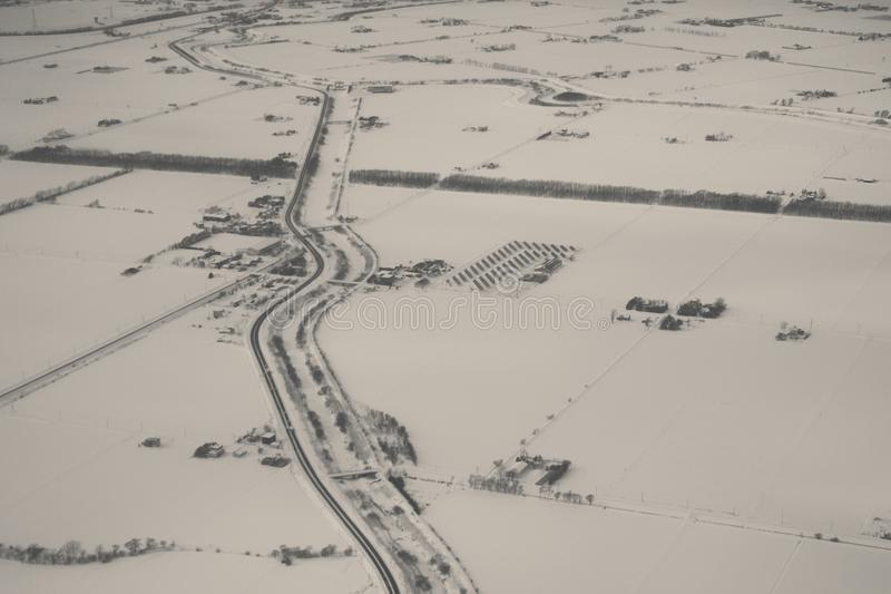 Aerial view of farm and road in winter stock photos
