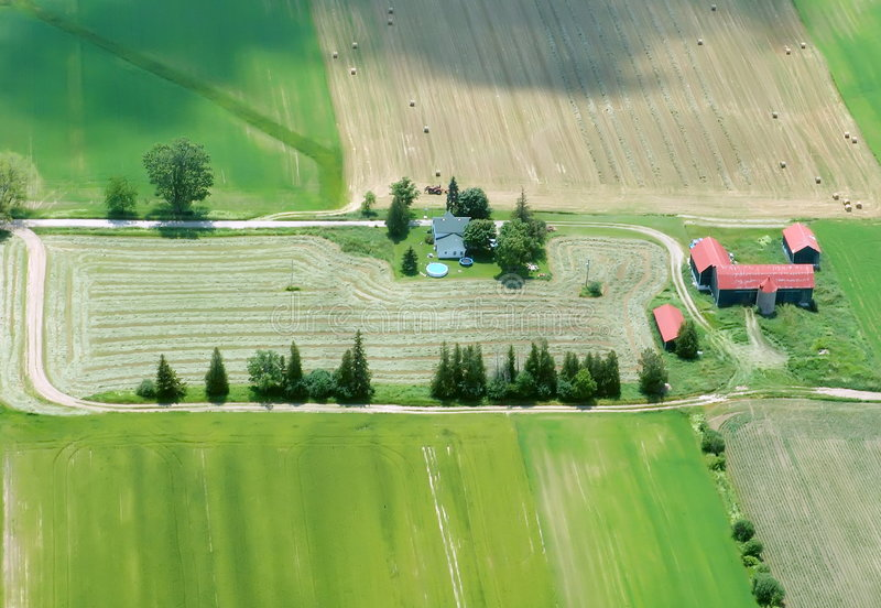 Aerial View Of Farming House With Red Roof Stock Photo