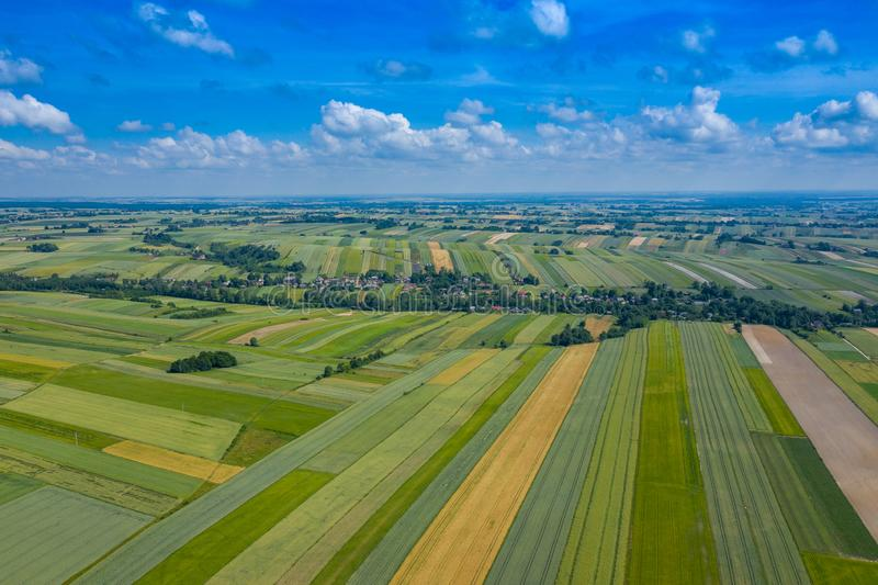 Aerial view of farmlands and mountains in rural Poland seen from drone. Summer time stock photos