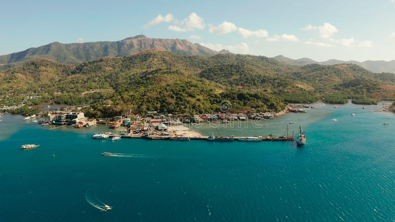 Sea port on the island of Busuanga, Philippines,Coron. Aerial view ferry port in the city of Coron, on the island Busuanga, Philippines.Ferries transport royalty free stock photo