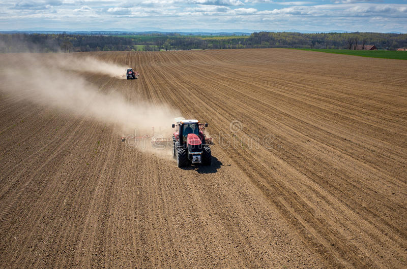 Aerial view of the field. Aerial view of the the tractor harrowing the large brown field in spring season royalty free stock photography