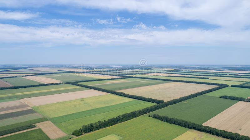 Aerial view of fields with various types of agriculture, against cloudy sky royalty free stock image
