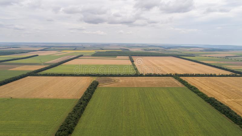Aerial view of fields with various types of agriculture, against cloudy sky. Aerial view of fields with various types of agriculture royalty free stock photography