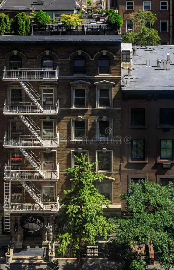 Aerial view of fire escape ladders and balconies in a residential building in Midtown Manhattan, New York, USA stock image