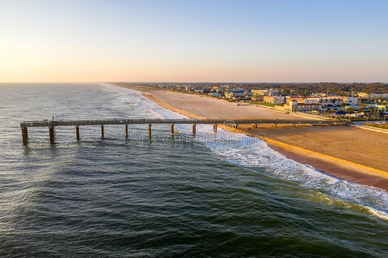 Aerial view of Fishing Pier in Saint Augustine Beach during sunrise royalty free stock image