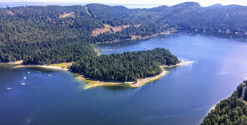 An aerial view from a float plane of montague bay on the tree covered Galiano island in the Gulf Islands of British Columbia royalty free stock images