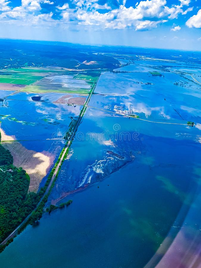 Flooded field with submerged roadways along the Missouri River. Aerial view of Flooded field and farmland with submerged roadways along the Missouri River in the royalty free stock image