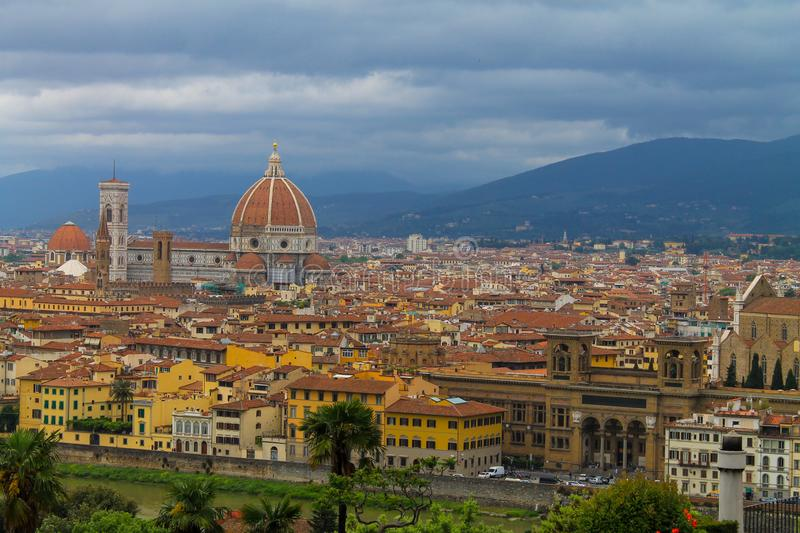 Aerial view of Florence Italy, beautiful old city full of historical amazing buildings, cathedrals and bridges. Famous tourist destination royalty free stock images