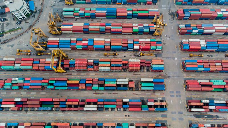 Aerial view from fly drone of shipping and freight import of goods and freight export and delivery to the international port. stock photos
