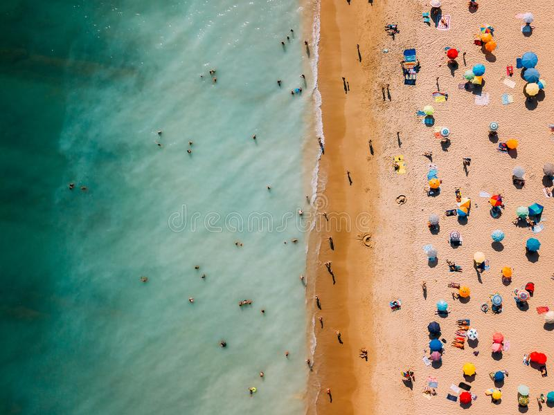 Aerial View From Flying Drone Of People Crowd Relaxing On Algarve Beach stock images