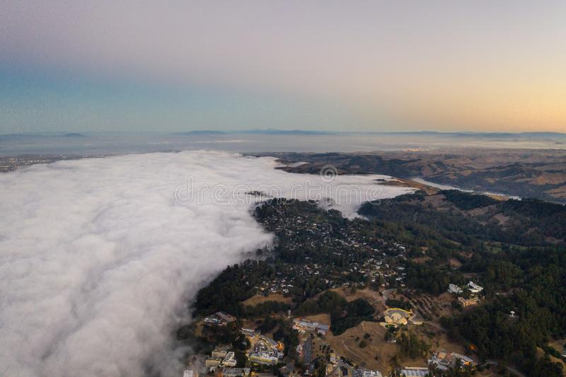 Aerial View of Fog in San Francisco Bay Area. The ever-present offshore marine layer in California is propelled inland in the San Francisco Bay area by a royalty free stock images