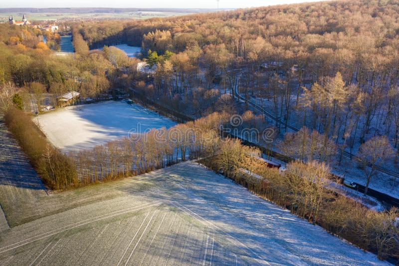 Aerial view of a football field of a district league team in a village with the first snow of the year. Drone shot royalty free stock photography