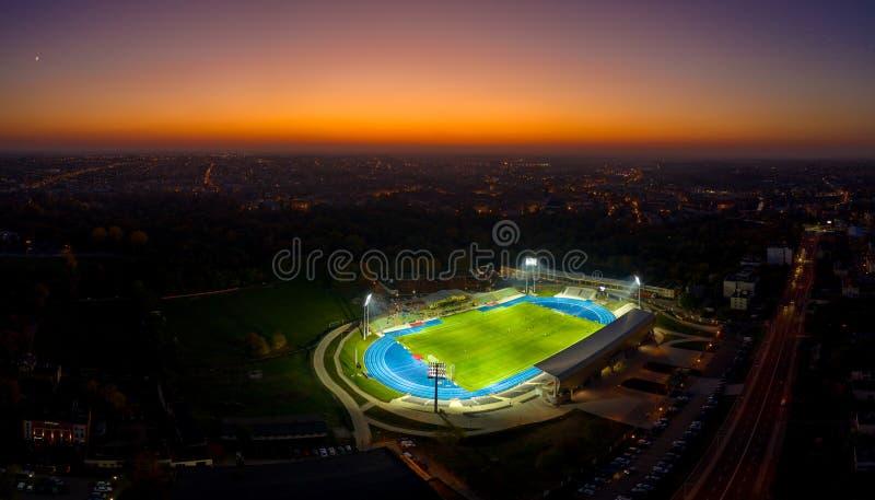 Aerial view on football stadium illuminated by jupiter on evening.  stock photos