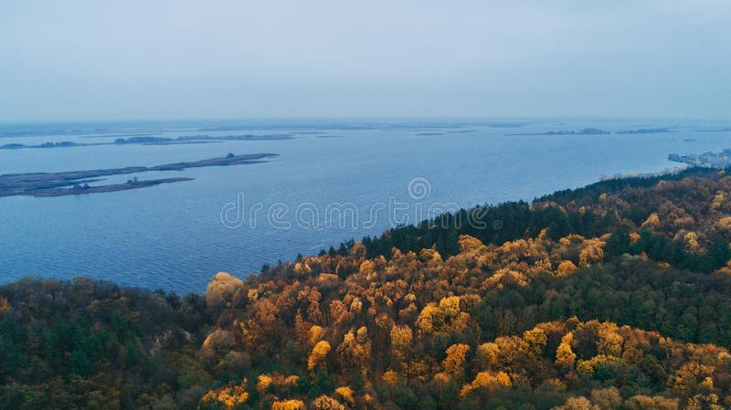 Aerial view of the forest. Yellow trees. Dnieper River. Aerial view of the forest. Yellow trees. Autumn. Dnieper River royalty free stock photo