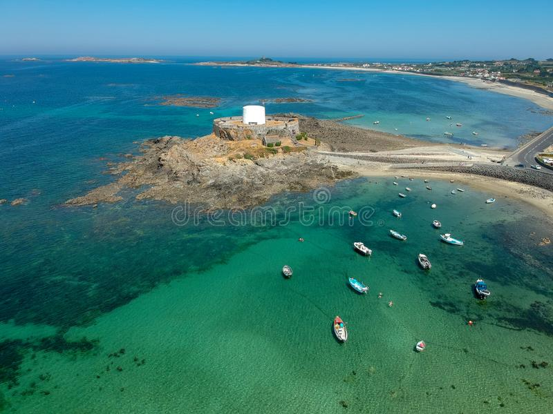 Aerial view Fort grey, West coast of Guernsey. Aerial view Fort grey, built in 1804 to defend the west coast of Guernsey. wonderful beach with white sand and royalty free stock image