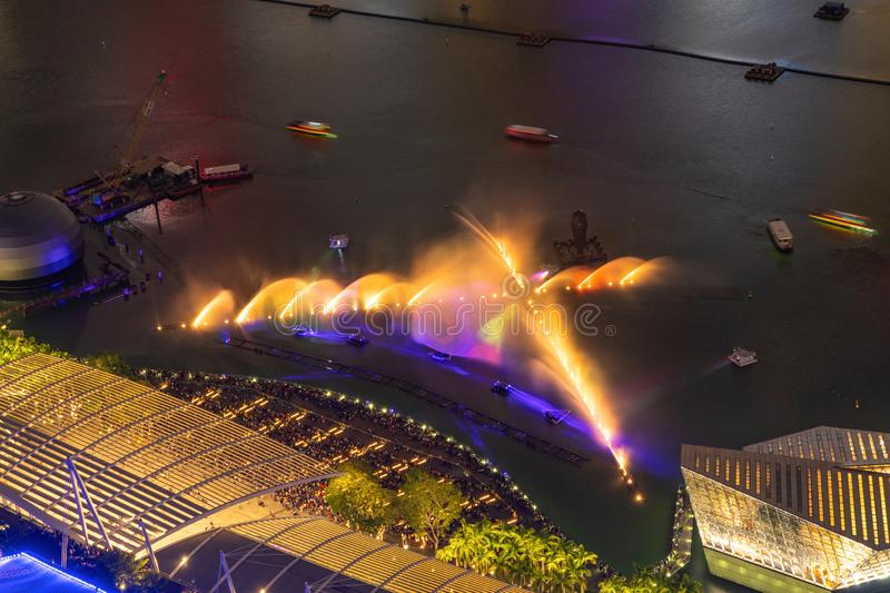 Aerial view of fountain show in Downtown Singapore city. Marina Bay area. Financial district and skyscraper buildings at night.  stock image