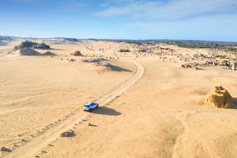 Aerial view of Four-wheel-drive car on Pinnacles Drive, dirt road in Pinnacles Desert, Nambung National Park, Western Australia., royalty free stock image