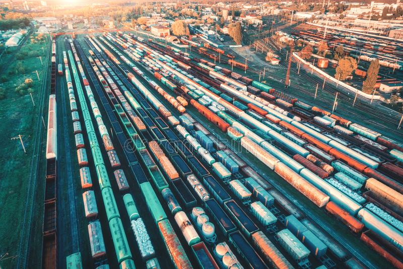 Aerial view of freight trains. Cargo wagons on railway station. Aerial view of freight trains. Colorful cargo wagons on railway station. Wagons with goods on royalty free stock image