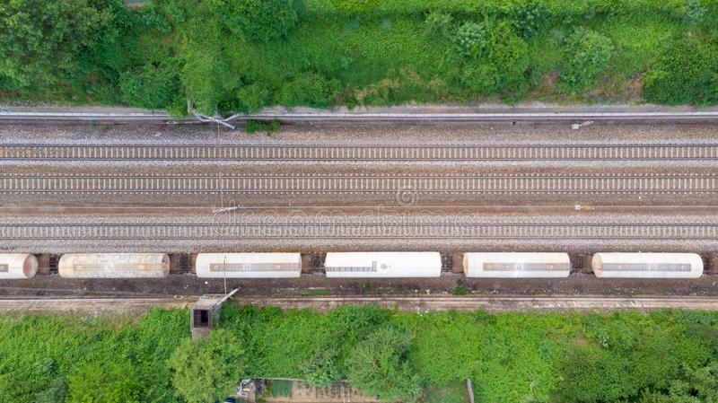 Aerial view freight trains in railway station. Cargo trains wagons on railroad, top down. Heavy industry conceptual, rail track in stock photos