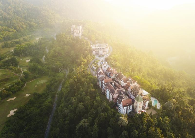 Aerial view of french style building at Bukit Tinggi with dramat. Ic fog and sunrise royalty free stock image