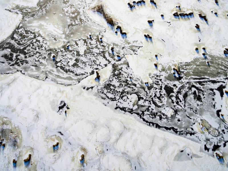 Aerial view of frozen forest lake in winter. Drone photography. abstract texture stock photo