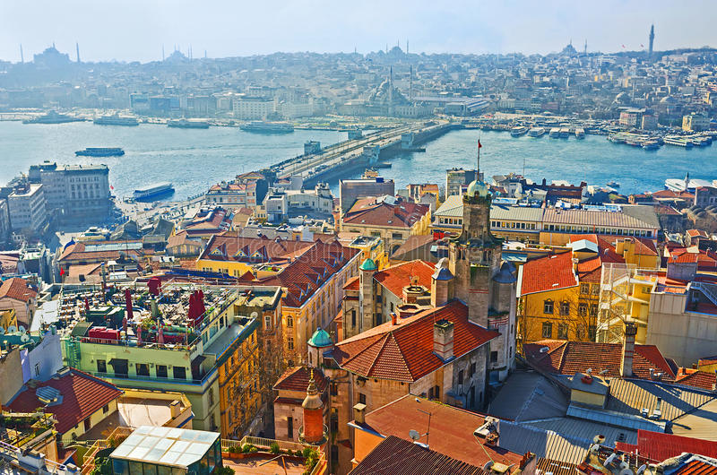 The aerial view of Galata bridge. The roofs of the old neighborhoods and the Galata bridge in the light morning haze, view from Galata Tower, Istanbul, Turkey stock image