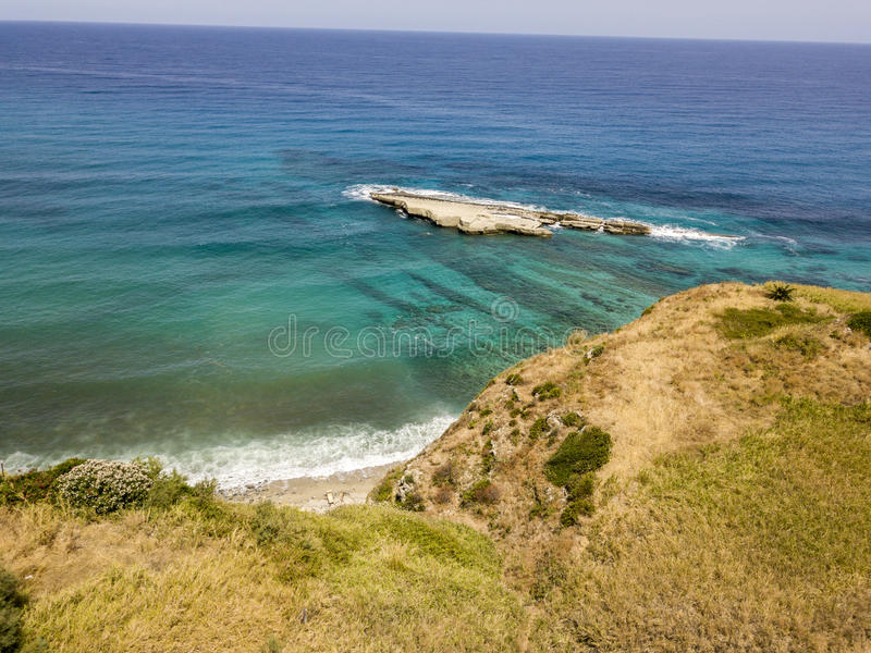 Aerial view of Galera Rock, Sant`Irene Bay in Briatico, Calabria, Italy. Aerial view of Sant`Irene Bay in Briatico, Calabria, Italy. Galera Rock. Tyrrhenian Sea royalty free stock photography