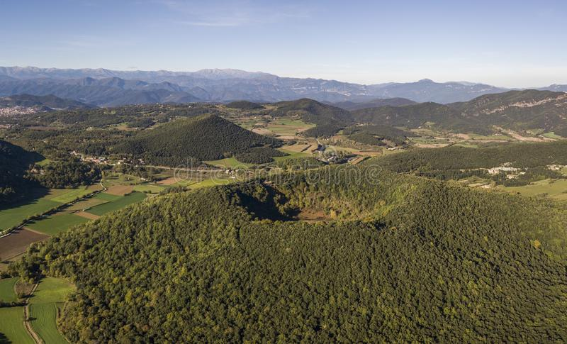 Aerial view of Garrotxa Volcanic Zone Natural Park and Santa Margarida Volcano in the foreground royalty free stock images