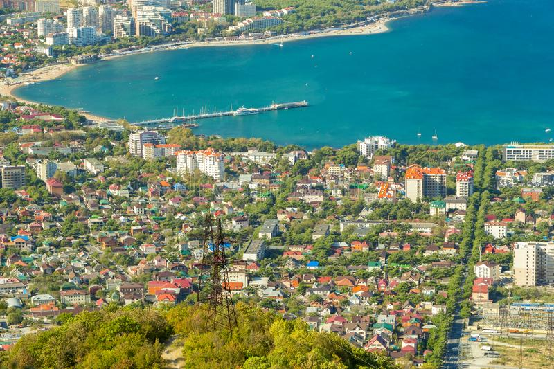 Aerial view of Gelendzhik resort city district from hill of caucasian mountains. Buildings, beaches and blue water of. Aerial view of Gelendzhik resort city stock photos