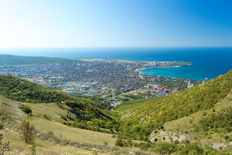 Aerial view of Gelendzhik resort city and sea bay. Day, Velvet season. Aerial view of Gelendzhik resort city and sea bay. Photo from hill of caucasian mountains stock photos