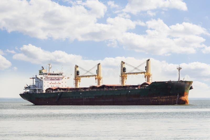Aerial view of general cargo ship in open sea. stock photos