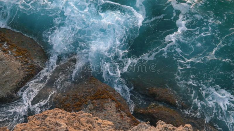 Aerial view of giant blue waves breaking on the rocks during the surf. Action. Sea element royalty free stock photography