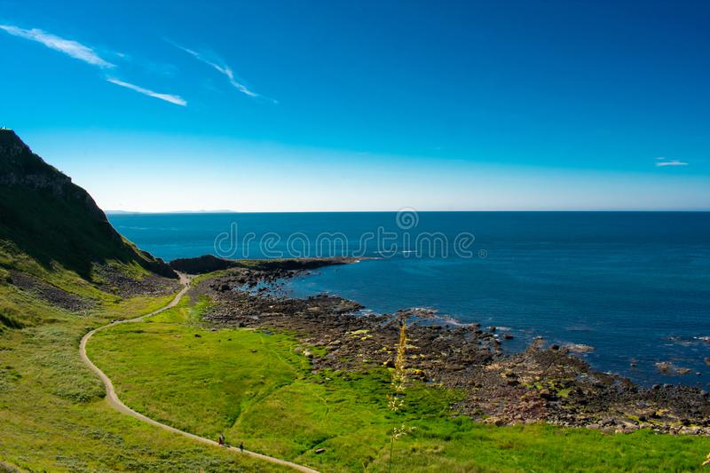 Aerial view of Giants Causeway most popular and famous landmark in Northern Ireland. Coast of Atlantic ocean and calm water stock images