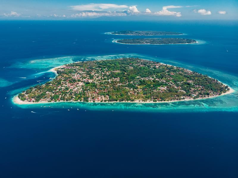 Aerial view with Gili islands and blue ocean. Gili Air, Meno with Trawangan. Aerial view with Gili islands and blue ocean. Gili Air, Meno and Trawangan stock photography