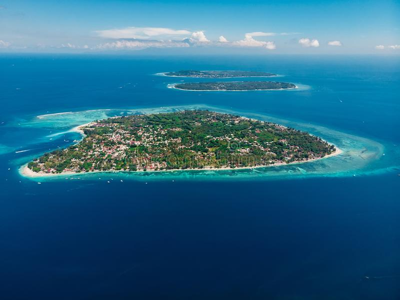 Aerial view with Gili islands and ocean, drone shot. Gili Air, Meno and Trawangan. Islands royalty free stock photo