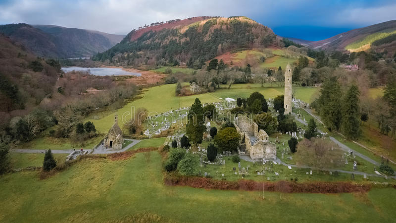 Aerial view. Glendalough. Wicklow. Ireland. Round tower and ruins of the monastic settlement of Glendalough. county Wicklow. Ireland