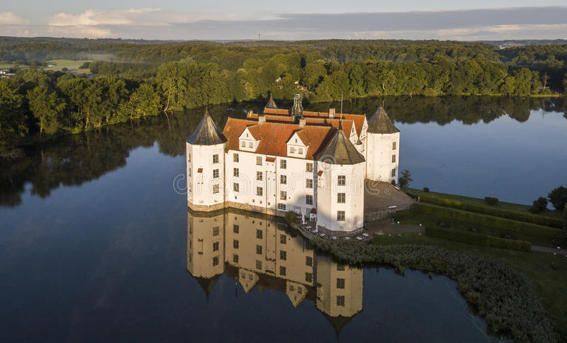 Aerial view of Glucksburg water castle at dawn, Germany. Aerial view of Glucksburg water castle in Germany at dawn stock images
