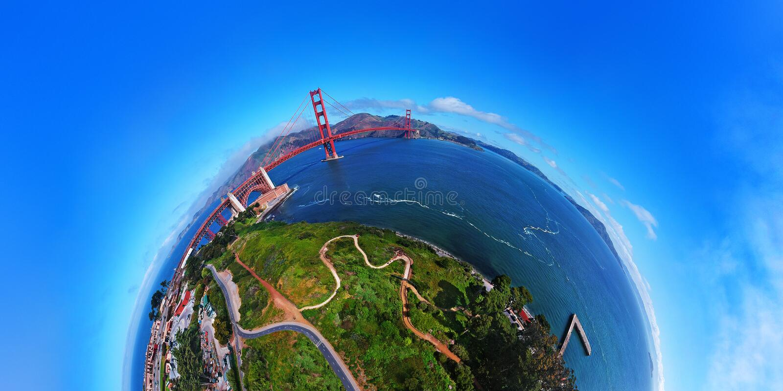 AERIAL VIEW OF GOLDEN GATE BRIDGE IN SAN FRANCISCO, CALIFORNIA. DRONE SHOT, PLANET PANORAMA 180 DEGREES. PACIFIC OCEAN stock images