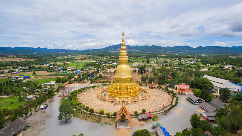 Aerial view Golden Pagoda Sri Vieng Chai Of Phra Phutthabat Huai Tom Temple Lamphun, Thailand royalty free stock image