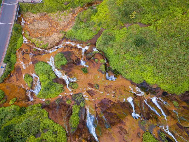 Aerial view of Golden waterfall. Nature landscape of Jinguashi in Ruifang area. it is located in New Taipei City, Taiwan for. Travel trip background, tourist stock photos