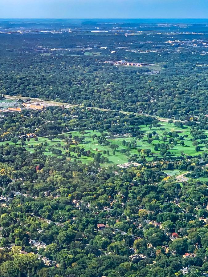 Aerial view of a golf course in a  densely forested urban development. Aerial view of a golf course in a densely forested planned urban development in a major US royalty free stock photography